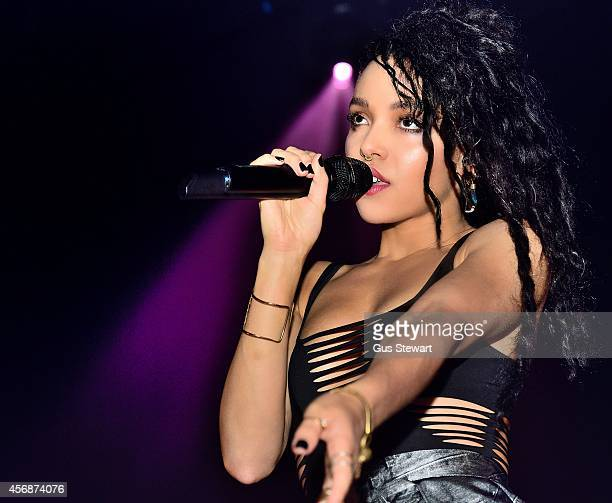 Twigs performs on stage at Hackney Empire on October 8 2014 in London United Kingdom