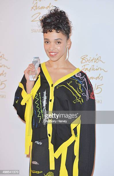 Twigs poses in the Winners Room at the British Fashion Awards 2015 at London Coliseum on November 23 2015 in London England