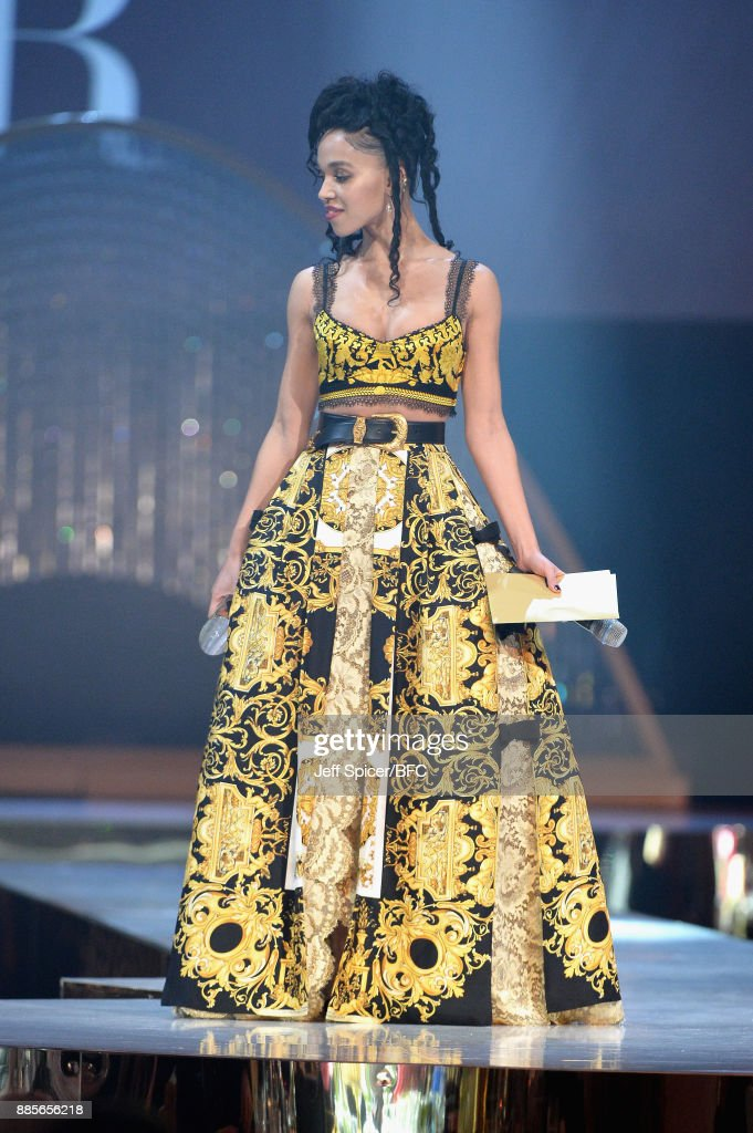Twigs presents the award for British Designer of the Year Menswear on stage during The Fashion Awards 2017 in partnership with Swarovski at Royal Albert Hall on December 4, 2017 in London, England.