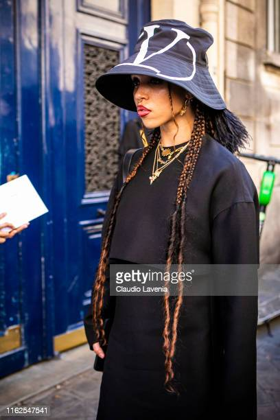 Twigs wearing a black dress and Valentino hat is seen outside VALENTINO show during Paris Fashion Week Haute Couture Fall/Winter 2019/2020 on July 03...