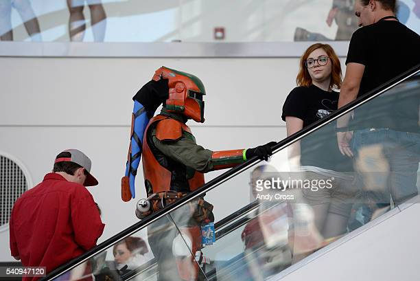 A Twi'lek Bounty Hunter Star Wars character heads up the escalator to the Denver Comic Con at the Colorado Convention Center June 16 2016