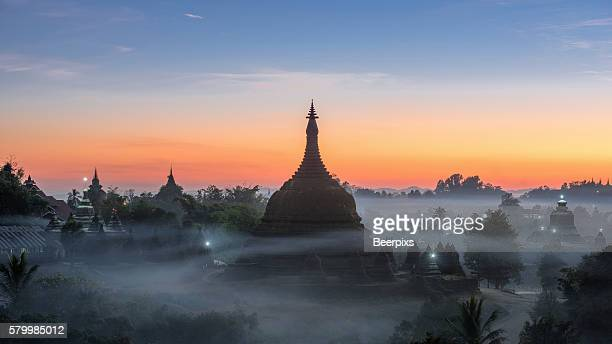 twilight at ratanabon paya in the mist in mrauk u, myanmar. - sittwe stock photos and pictures