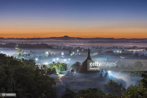 Twilight at Ratanabon Paya in the mist in Mrauk U, Myanmar. Top view.