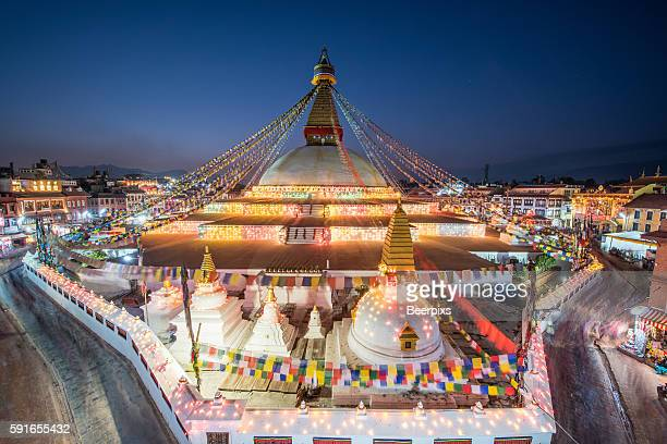 twilight at the boudhanath stupa in kathmandu, nepal. - nepal stock pictures, royalty-free photos & images