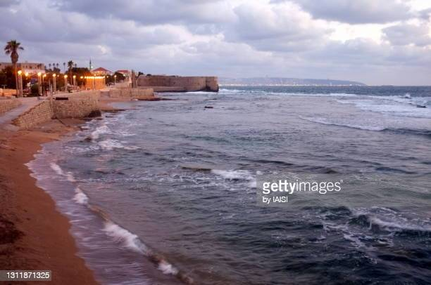 twilight at the walled port-city and the bay of acre, northern israel - history stock pictures, royalty-free photos & images