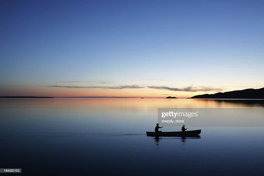 XL twilight canoeing : Stock Photo
