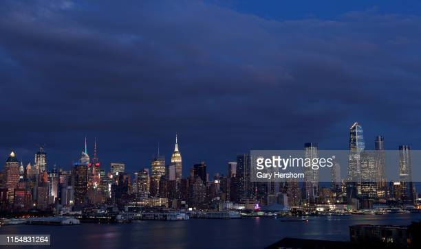Twilight falls on the skyline of midtown Manhattan in New York City at sunset on June 6, 2019 as seen from West New York, New Jersey.