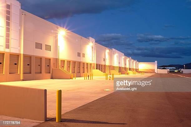twilight industrial building - loading dock stock pictures, royalty-free photos & images