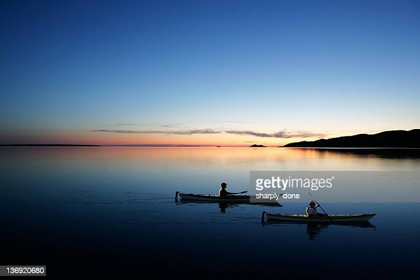 xxl twilight kayakers - sunset lake stock photos and pictures