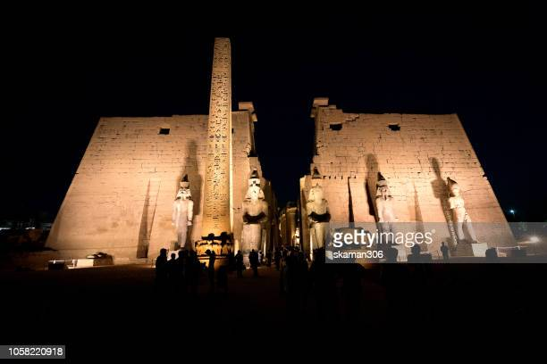 twilight landscape ruins statue pharoah and obelisk  at luxor temple near nile river luxor (thebes) egypt - luxor thebes stock pictures, royalty-free photos & images