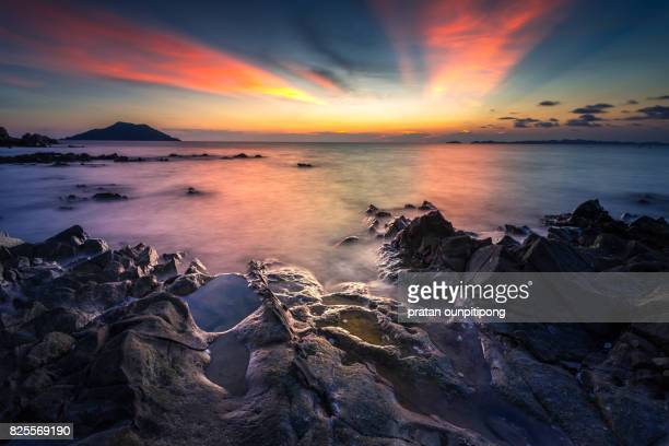 twilight on a rock - chanthaburi sea stock pictures, royalty-free photos & images