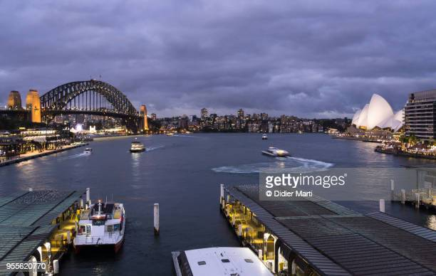 Twilight over the Circular quay ferry terminal and the harbour  bridge in Sydney