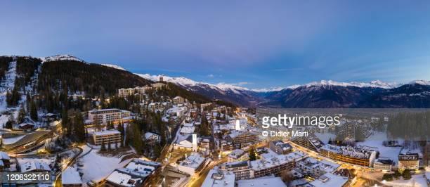 twilight over the crans montana ski resort in the swiss alps in valais, switzerland - crans montana - fotografias e filmes do acervo