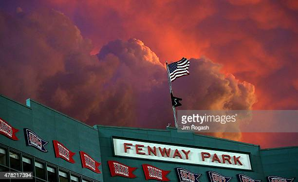Twilight settles over Fewnay Park during a game between the Boston Red Sox and the Baltimore Orioles in the fourth inning at Fenway Park on June 23,...