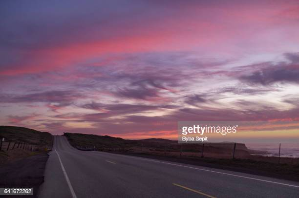 Twilight Sky Full of Magenta Clouds over a Road