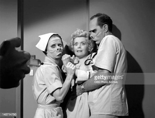 Twilight Zone episode 'Eye of the Beholder' written by Rod Serling Donna Douglas as patient Janet Tyler being held by William D Gordon as the doctor...