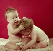 twin baby girls one pulling others