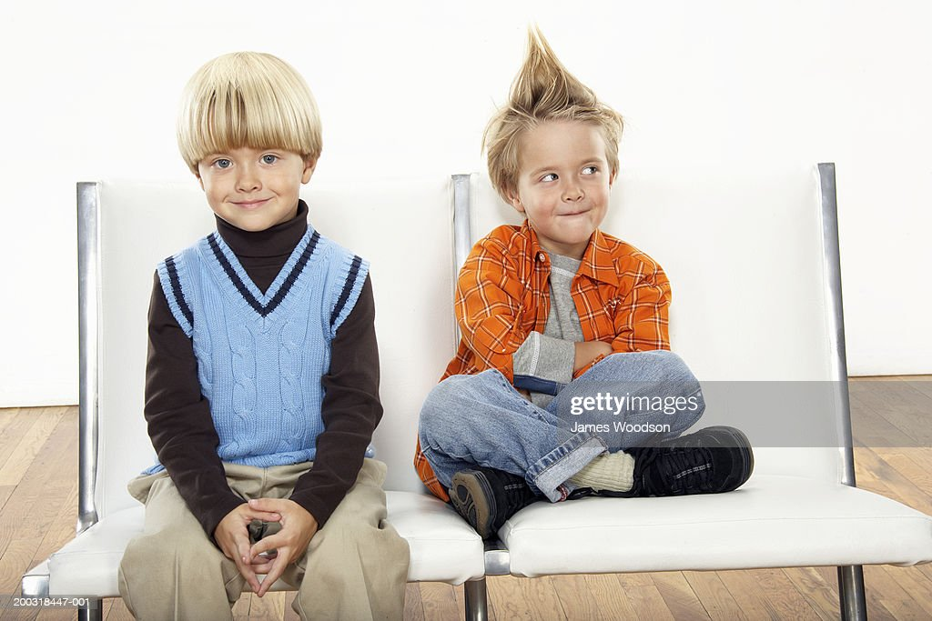 Twin boys (3-5) wearing formal and casual attire, portrait : Stock Photo