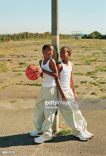 Twin boys with basketball