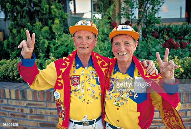 Twin brothers going to Spanish football match