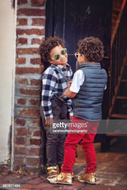 twin brothers in sunglasses, having a chat in a city scene - downtown comedy duo stock pictures, royalty-free photos & images