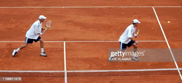 Twin brothers Mike and Bob Bryan of US watch a ball returned by a Slovak couple Dominik Hrbaty and Karol Beck during Davis cup World group playoff...