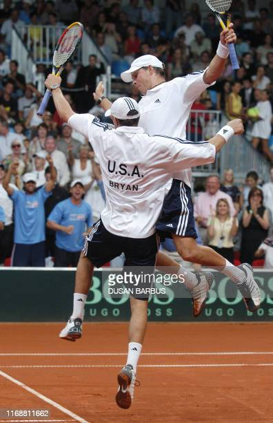 Twin brothers Mike Bryan and Bob Bryan of the US celebrate their victory over Slovak couple Dominik Hrbaty and Karol Beck during a Davis Cup doubles...