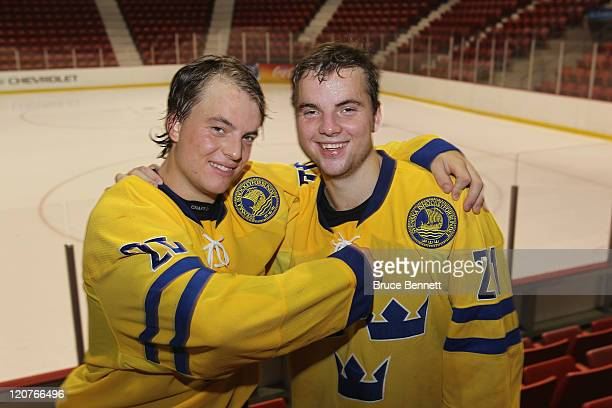 Twin brothers Pathrik and Ponthus Vesterholm of Team Sweden pose for a photo following their 7-1 victory over Team Finland at the Lake Placid Olympic...