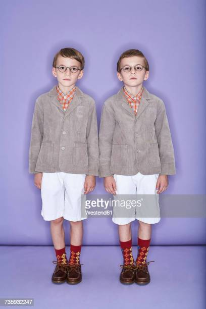 twin brothers - adjust socks stock pictures, royalty-free photos & images