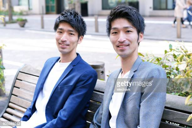 twin brothers - asian twins stock photos and pictures