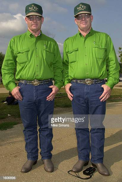 Twin brothers Ralph left and Russell Scott pose for a photo during the Twinsburg Twins Days Festival August 3 2001 in Twinsburg Ohio