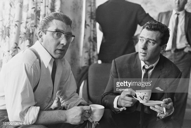 Twin brothers Ronald and Reginald Kray at home after 36 hours of police questioning concerning the murder of George Cornell, UK, 1966. Cornell, a...