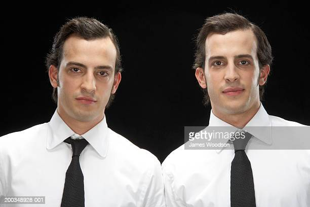 twin brothers wearing suits, portrait, close-up - brown eyes stock pictures, royalty-free photos & images