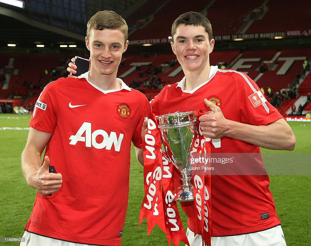 Twin brothers William Keane and Michael Keane of Manchester United Academy Under-18s celebrate with the FA Youth Cup trophy after the FA Youth Cup Final Second Leg match between Manchester United Academy Under-18s and Sheffield United Academy Under-18s at Old Trafford on May 23, 2011 in Manchester, England.