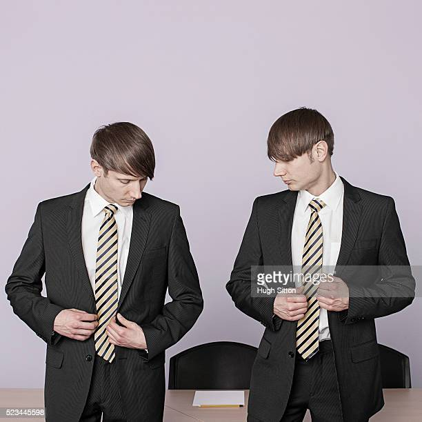 twin businessmen in similar suits - hugh sitton stock pictures, royalty-free photos & images