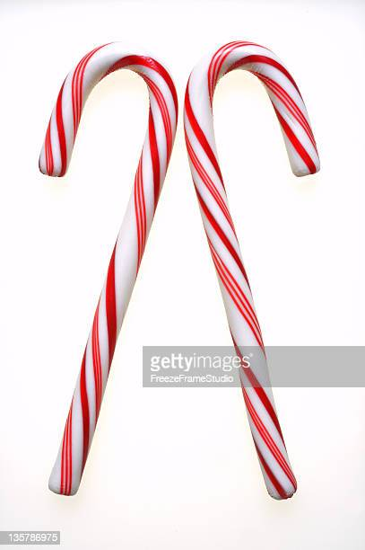 twin candy canes - candy cane stock pictures, royalty-free photos & images