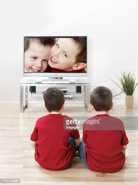 Twin children watching TV