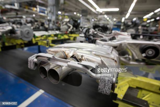 Twin exhausts sit on a powertrain system on the MercedesBenz SClass automobile production line at the automaker's factory in Sindelfingen Germany on...