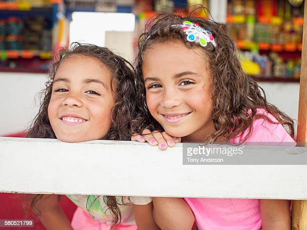 Twin girls at fireworks stand