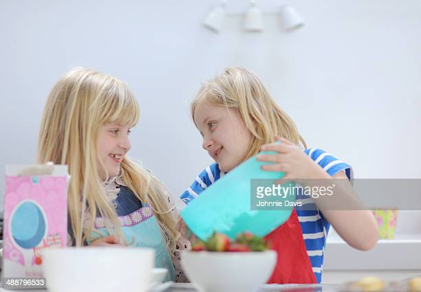 twin girls having fun while baking