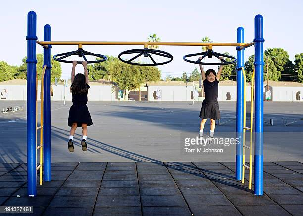 Twin girls playing on playground