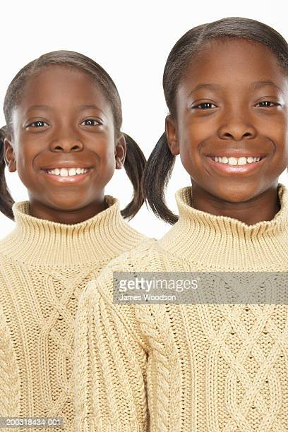 twin girls (7-9) smiling, portrait - identical twin stock pictures, royalty-free photos & images
