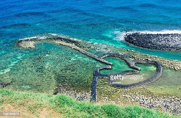 Twin heart stone weir in seacoast