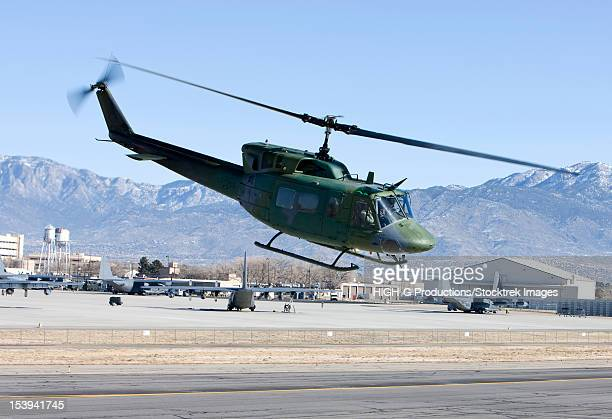 A UH-1N Twin Huey from the 512th RQS flies a training mission near Kirtland Air Force Base, New Mexico.