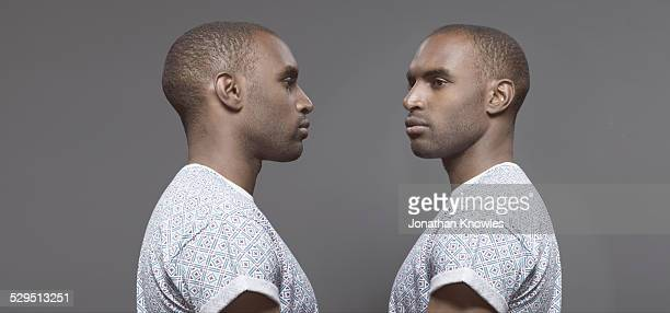 twin image, dark skinned male - side view stock pictures, royalty-free photos & images