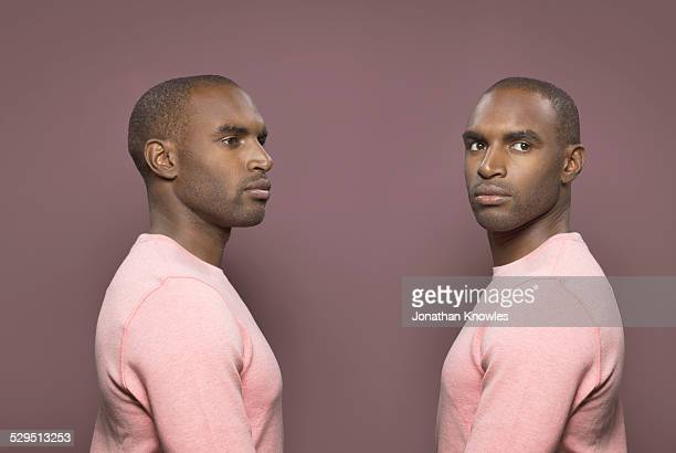 twin image, dark skinned male - symmetry stock pictures, royalty-free photos & images