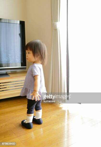 Twin little girl in living room