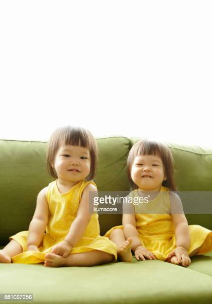 Twin little sisters smiling