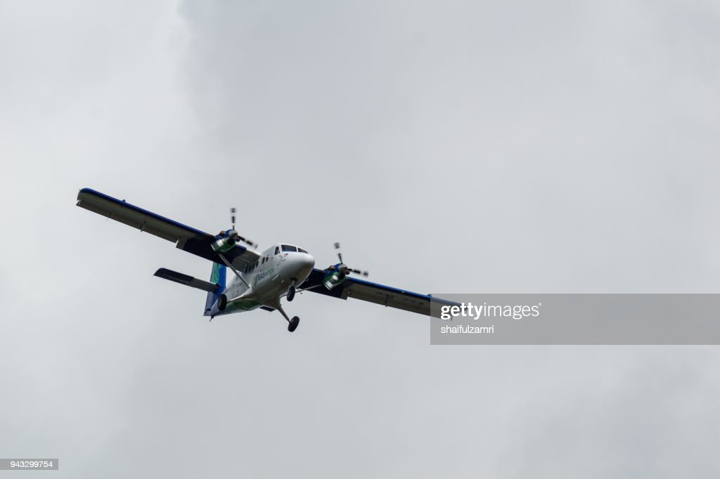 A twin otter aircraft from Malaysia Airlines over Bario highland area. The flight will took 1 hour compared to 11 hours by land from Miri due to rural road condition. : Stock Photo