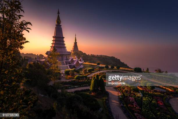 twin pagodas on the top of doi inthanon national park in chiang mai, thailand. - south east asia stock pictures, royalty-free photos & images